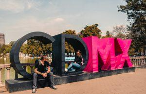 4 days in Mexico City Cover Photo (us sitting on the big sign CDMX)