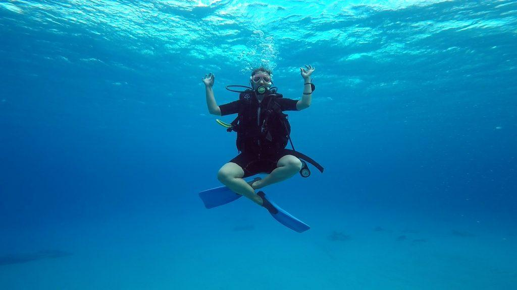 Yoga pose under water while scuba diving in Cozumel, Mexico