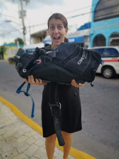 "Holding diving equipment packed in a ""taco roll"" (our first scuba diving in Cozumel)"