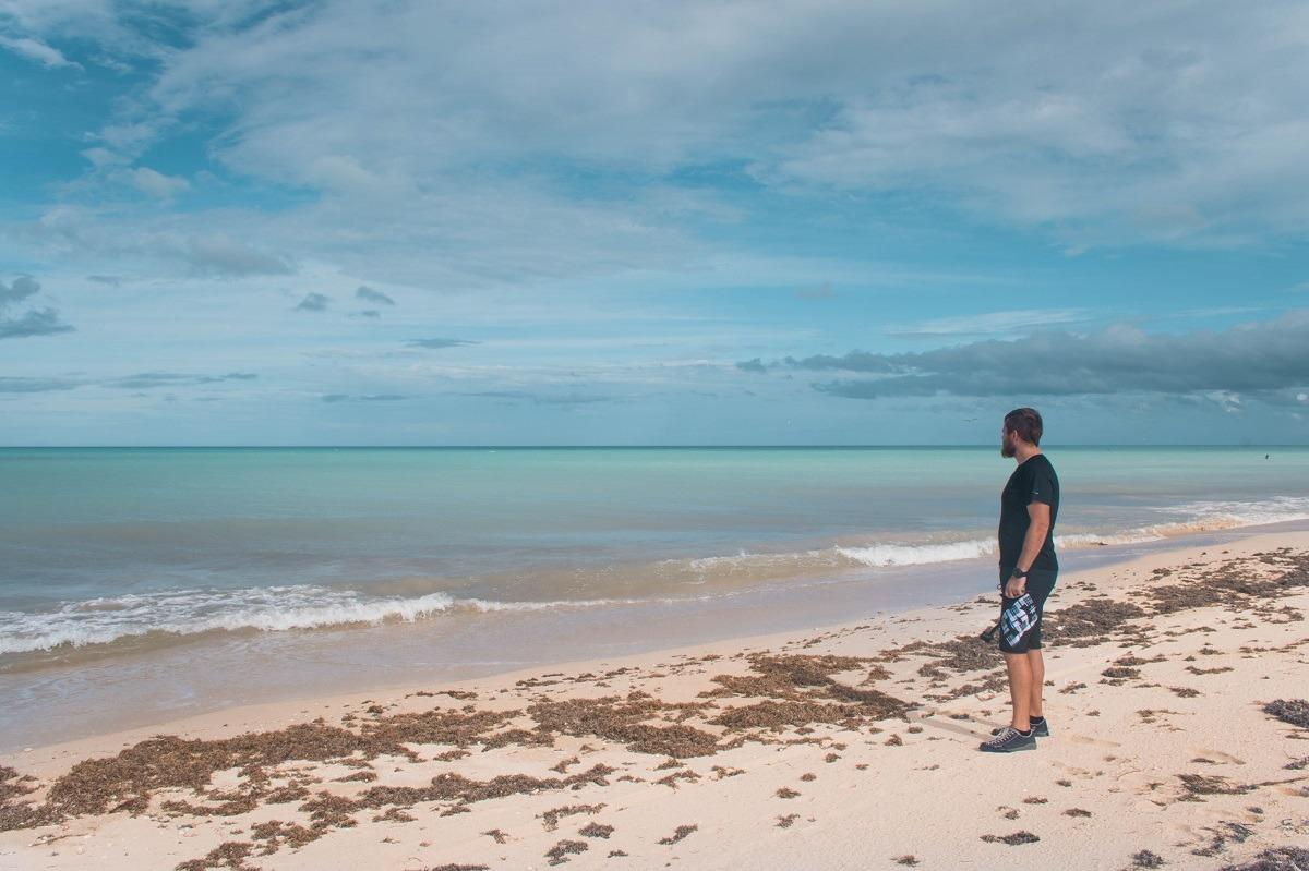 Bojan on one of the sandy beaches near Tulum. Torquise ocean is beautiful.(One month Mexico Itinerary)
