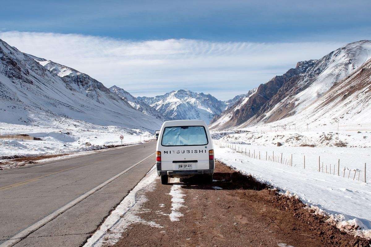 Van in a snowy environment of Andes border crossing
