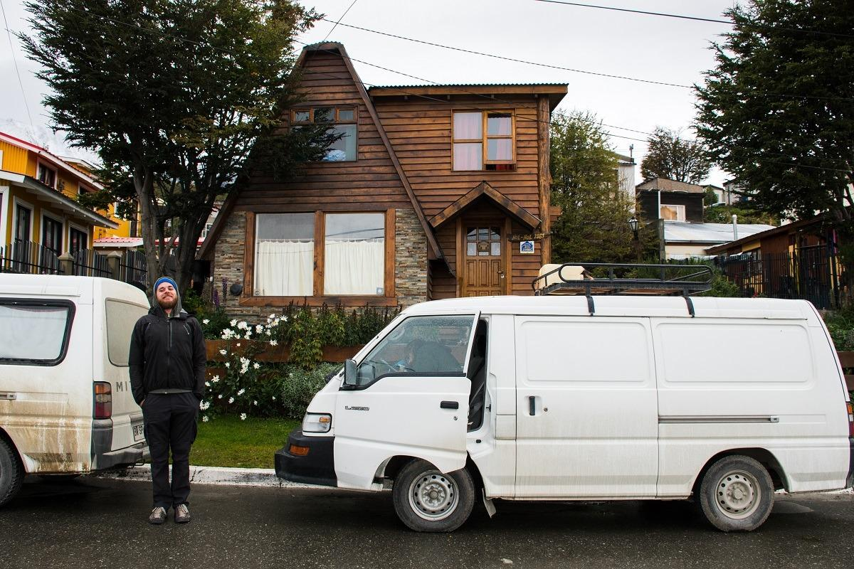 Bojan and both vans in front of the wooden cottage where we spent the night after hiking in Ushuaia.
