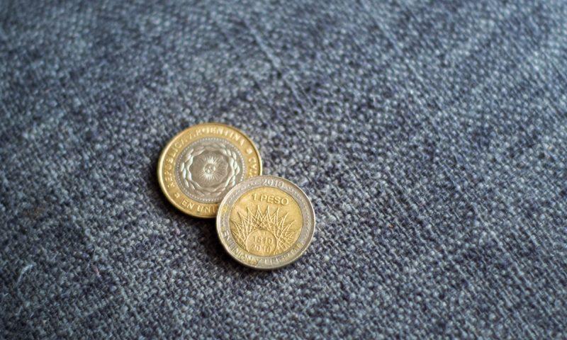 Stroški potovanja za Argentino - kovanca argentinskega pesota