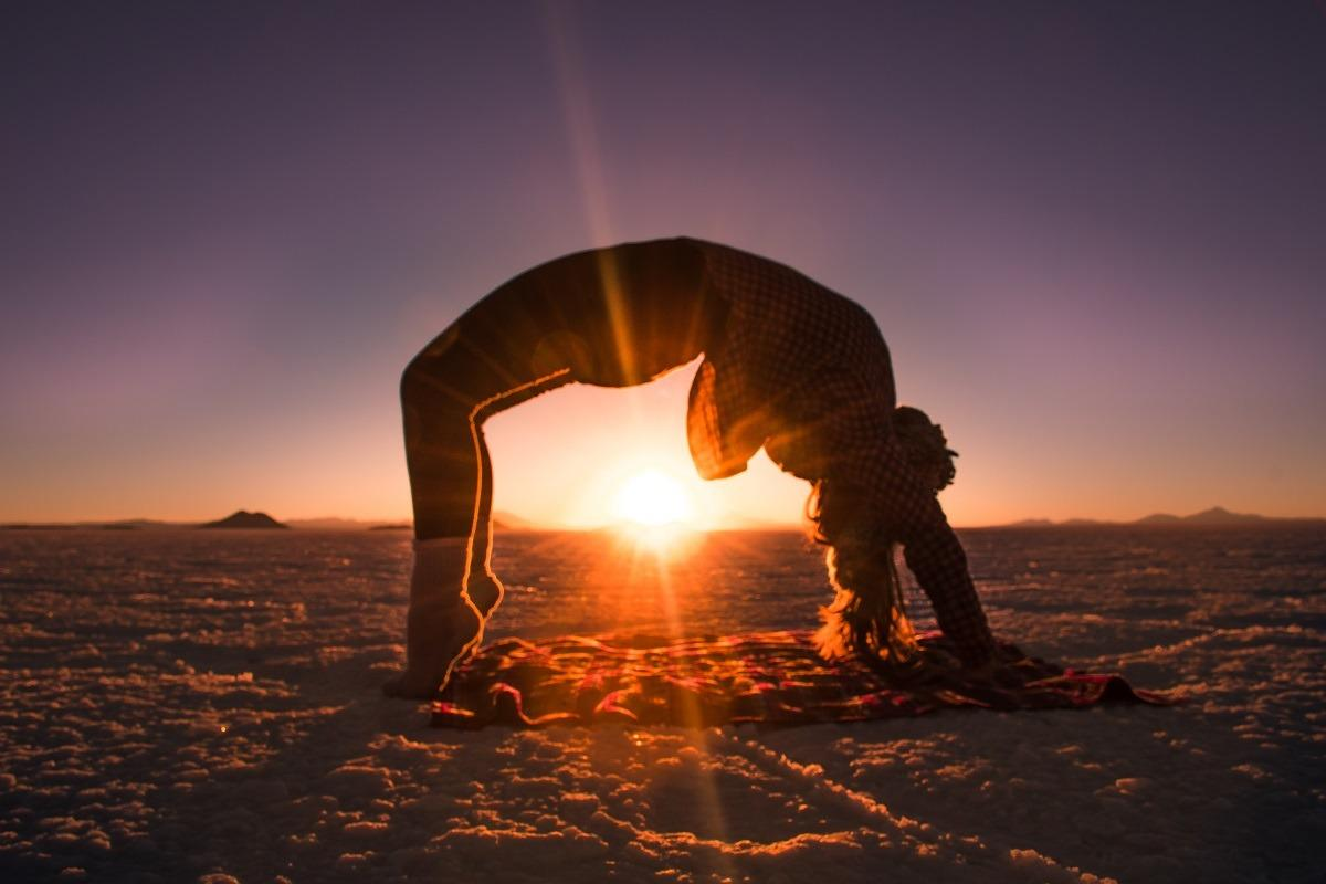 Yoga pose at sunset at Salar de Uyuni