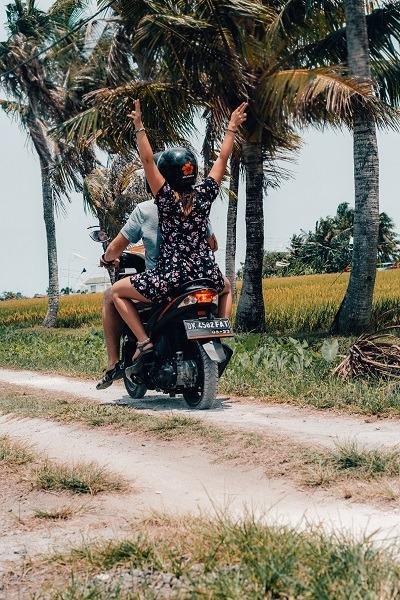 Us on a Motorbike in Bali - palm trees and rice fields (our yearlong honeymoon)