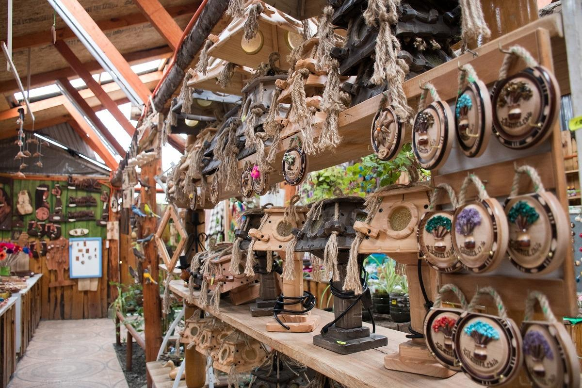 Hand craftedwooden souvenirs at Artesania Market (Unique towns in Patagonia)