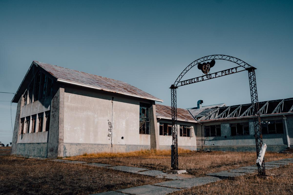Deserted school with rusty Mickey Mouse sign (Unique towns in Patagonia)
