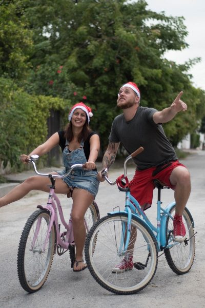 Us on baby blue and pink bikes with Xmas hats