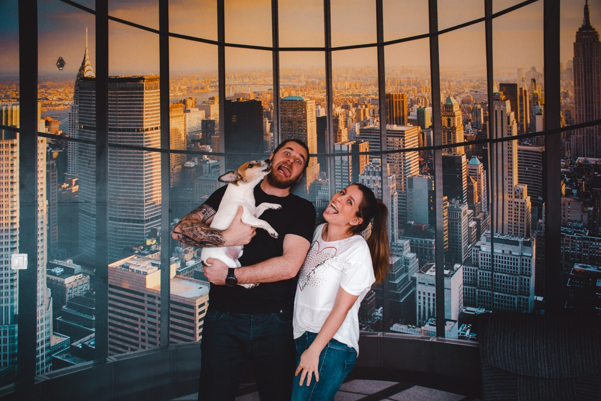 Us in front of New York wallpaper (fuel your wanderlust from home)