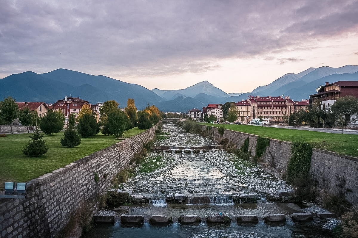River channel and houses in Bansko Bulgaria (one of the best stops on a Balkan trip)