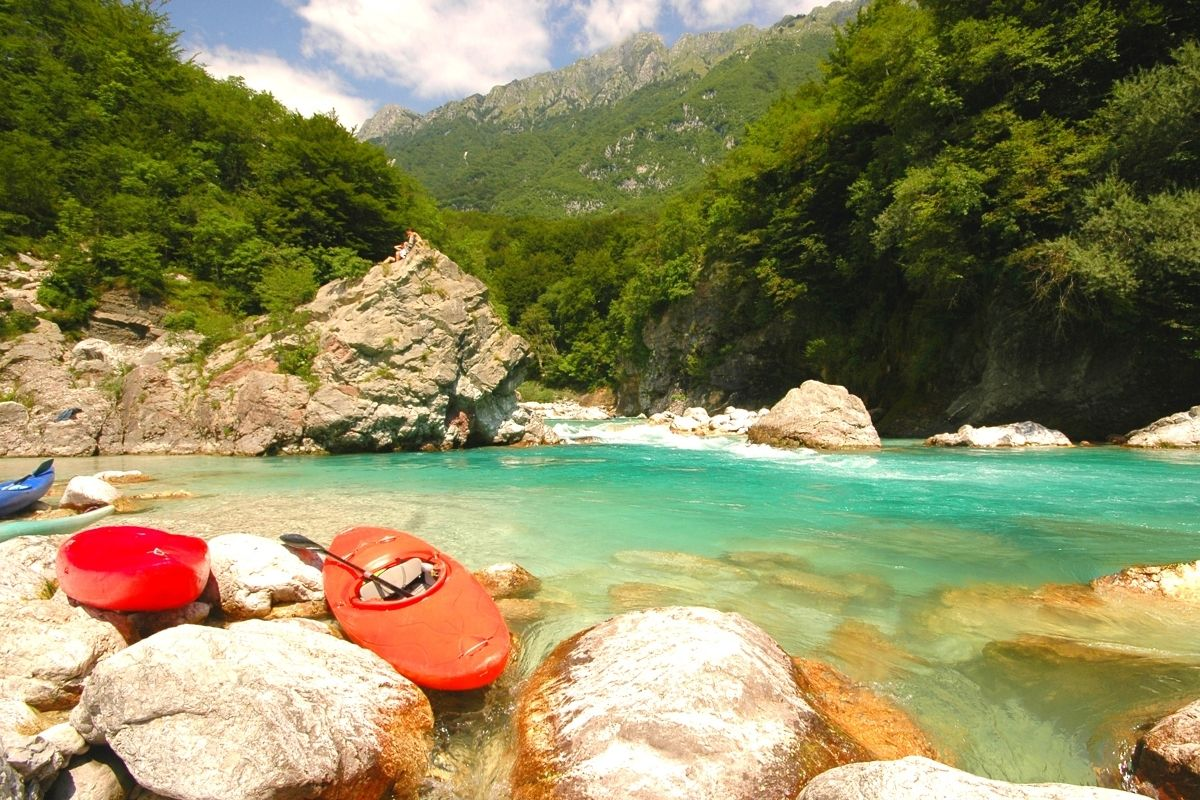 Kayaks by the Soca river, one of top outdoor adventures in Slovenia