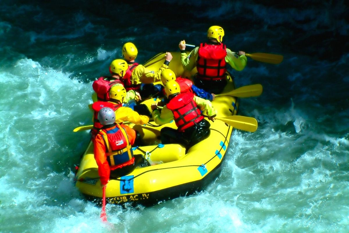 People on raft on Soca river, one of top outdoor adventures in Slovenia