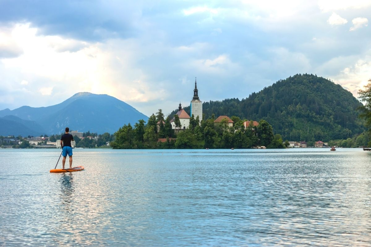 A guy on a SUP board on Bled Lake